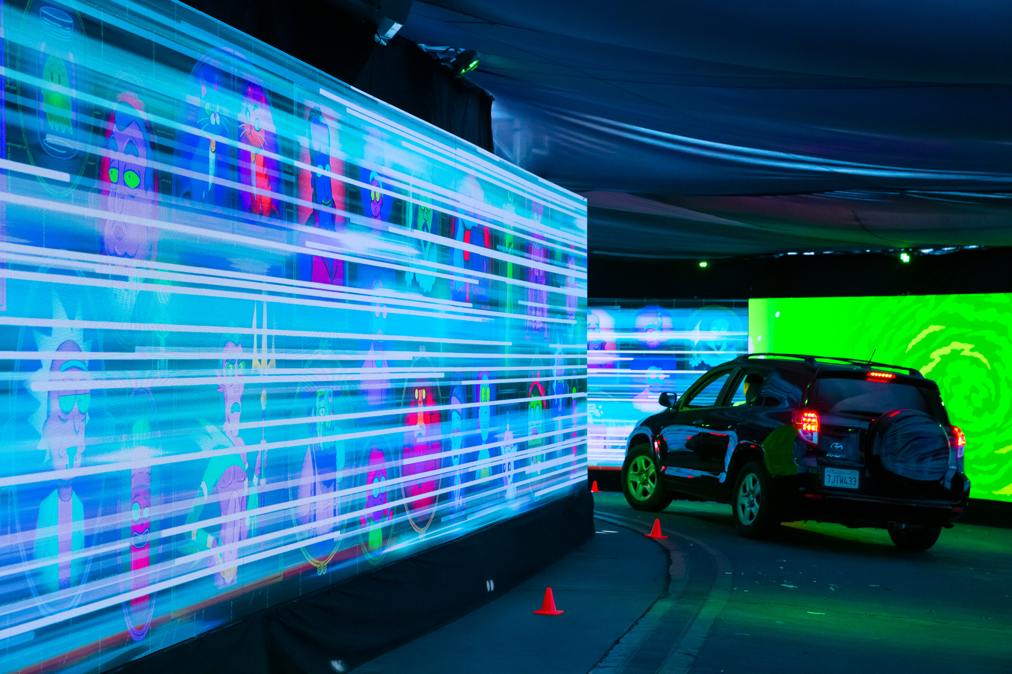 "Car driving through ""Morty's"" LED drive-thru"